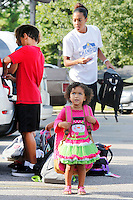NWA Democrat-Gazette/DAVID GOTTSCHALK  Chloe Washington, 2, wears a donated backpack filled with school supplies before bringing it into Asbell Elementary School Monday, August 3, 2015 in Fayetteville. Chloe is participating in The Grove Church's fourth annual Packs for Life program which collects and donates age specific school supplies. Asbell Elementary School begins today.