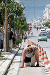 A Pilgrim crawl on her hands and knees to the shrine in the hope of miracles and blessings. Tinos, Greece