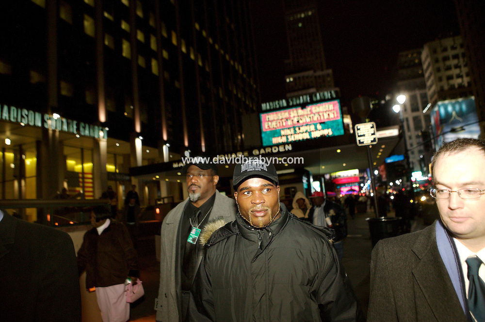 8 January 2006 - New York City, NY - French boxer Jean-Marc Mormeck (C) leaves the Madison Square Garden in New York City, USA, early 8 January 2006, after loosing the World Cruiserweight Championship unification fight by KO in the 10th round to Jamaican O'Neill Bell.