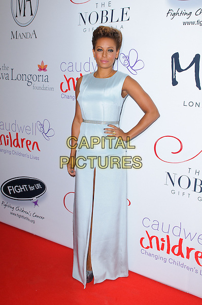 Melanie Brown ( Mel B ) of the Spice Girls.The Noble Gift Gala, ME London, The Strand, London, England..8th December 2012..full length hand on hip white dress silver sleeveless slit split blue maxi .CAP/CJ.©Chris Joseph/Capital Pictures.