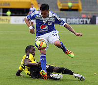 BOGOTA - COLOMBIA - 3 -06 -2013: José Luis Tancredi (Der) jugador de Millonarios , disputa el balón con Castillo  (Izq) de Alianza Petrolera   durante partido en el estadio Nemesio Camacho El Campín   de la ciudad de Bogotá , junio 3  de 2013. partido por la  fecha Diez y ocho de la Liga Postobon I. (Foto: VizzorImage / Felipe Caicedo / Staff).  José Luis Tancredi(Right) Millonarios player, fights for the ball with  Castillo (Left) of Alianza Petrolera  during party in the stadium Nemesio Camacho El Campin in Bogota, June 3, 2013. match the date of Eighteen postobon  League I.<br /> VizzorImage / Felipe Caicedo / Staff