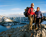 USA, Oregon, couple hiking with snow capped mountains, Crater Lake National Park