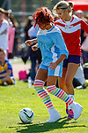 London, UK on Sunday 31st August, 2014. Amy Childs holds off the challenge from Rachel Riley during the Soccer Six charity celebrity football tournament at Mile End Stadium, London.