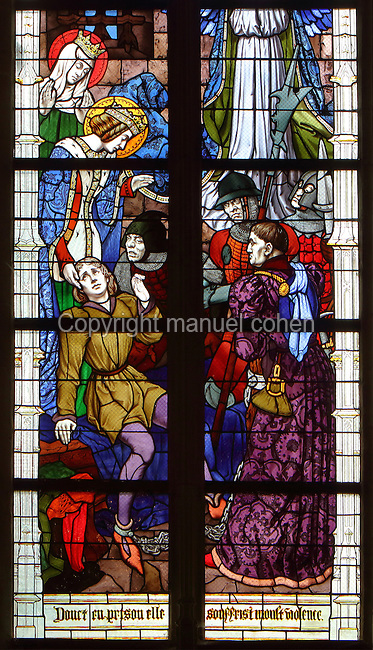 St Joan of Arc in prison, 1429-31, from a series of 19th century stained glass windows by Galland and Gibelin illustrating the life of Joan of Arc, in Orleans Cathedral, or the Basilique Cathedrale Sainte-Croix d'Orleans, built in Gothic style 1278-1329 and largely rebuilt 1601-1829 after it was partially destroyed in 1568, in Orleans, Loiret, Centre, France. The cathedral is listed as a historic monument. Picture by Manuel Cohen