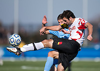 Dakota Edwards (18) of Maryland clears the ball away from Martin Murphy (8) of North Carolina during the game at the Maryland SoccerPlex in Germantown, MD. Maryland defeated North Carolina, 2-1,  to win the ACC men's soccer tournament.