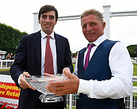 Connections of  Robin Weathers receive their trophy from the sponsors  CPA Scaffolding after winning the CPA Scaffolding Maiden Stakes during Ladies Evening Racing at Salisbury Racecourse on 15th July 2017