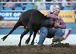 Aaron Vosler competes in the steer wrestling event at the Reno Rodeo in Reno, Nev., on Thursday, June 27, 2013.<br /> Photo by Cathleen Allison