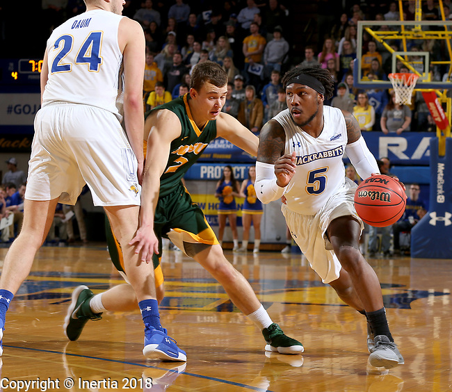 BROOKINGS, SD - FEBRUARY 1: David Jenkins Jr. #5 from South Dakota State University gets a step around Paul Miller #2 from North Dakota State University during their game Thursday at Frost Arena in Brookings. (Photo by Dave Eggen/Inertia)