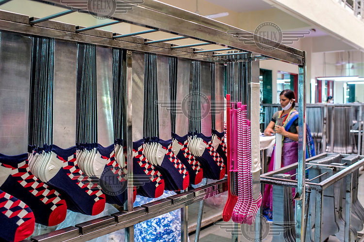 A woman working at the Mustang Socks Factory.