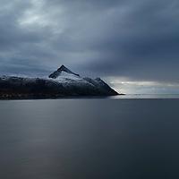 Skottind mountain peak with dusitng of autumn snow, Vestvågøy, Lofoten Islands, Norway