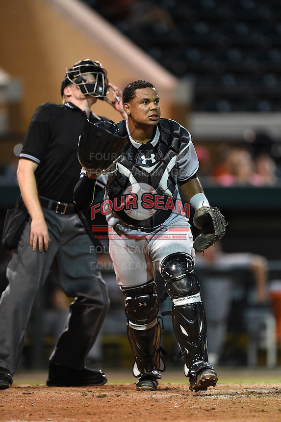 Tampa Yankees catcher Isaias Tejeda (27) backs up a play on a pop up during a game against the Lakeland Flying Tigers on April 9, 2015 at Joker Marchant Stadium in Lakeland, Florida.  Tampa defeated Lakeland 2-0.  (Mike Janes/Four Seam Images)