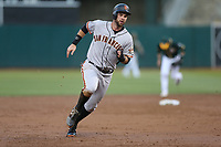 OAKLAND, CA - AUGUST 1:  Brandon Belt #9 of the San Francisco Giants runs the bases against the Oakland Athletics during the game at the Oakland Coliseum on Tuesday, August 1, 2017 in Oakland, California. (Photo by Brad Mangin)