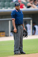 Umpire Erik Hill handles the calls behind the plate during a South Atlantic League game between the Delmarva Shorebirds and the Kannapolis Intimidators at Fieldcrest Cannon Stadium July 5, 2009 in Kannapolis, North Carolina. (Photo by Brian Westerholt / Four Seam Images)