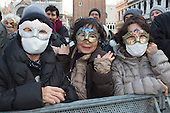 Venice, Italy. Tourists from Japan. People dress in costumes and wear masks as they celebrate the 2015 Carnival in Venice, Italy.