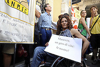 Roma 7 Luglio 2010.Piazza Monte Citorio.Manifestazione dei cittadini disabili contro i tagli della manovra economica del governo Berlusconi.Rome, July 7, 2010.Piazza Monte Citorio.Demonstration of disabled citizens against economic maneuver cuts of the Berlusconi government..