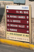 Street sign in the village Saint Seurin de Cadourne pointing to the town hall mairie and the chateaux Bel Orme, Pontoise Cabarrus, La Hontete, Sociando Mallet and the tourist office Medoc Bordeaux Gironde Aquitaine France
