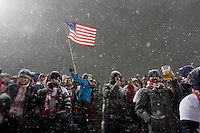 Under a heavy snowfall, USA fans watch the USA Men's National Team's World Cup Qualifier against Costa Rica  at Dick's Sporting Good Park in Commerce City, CO on March 22, 2013.