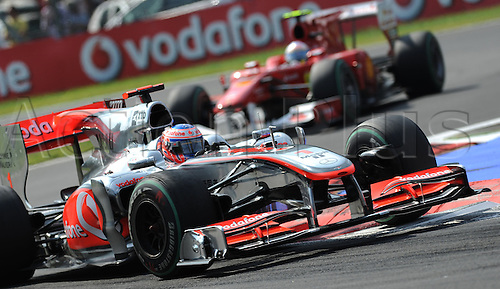 British driver Jenson Button of Mc Laren Mercedes steers his car ahead of Spanish driver Fernando Alonso of Ferrari during the 2010 Formula One Italian Grand Prix at the Autodromo Nazionale in Monza, Italy.