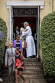 United States President Barack Obama walks with daughters Sasha (front) and Malia (behind) as First Lady Michelle Obama hugs Reverend Dr. Luis Leon after an Easter church service at St John's Episcopal Church  in Washington, Sunday, March 31, 2013..Credit: Drew Angerer / Pool via CNP