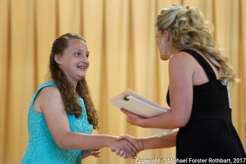 The Oneonta Greater Plains elementary school fifth grade awards ceremony, on June 21, 2017.<br /> &copy; Michael Forster Rothbart Photography<br /> www.mfrphoto.org &bull; 607-267-4893<br /> 34 Spruce St, Oneonta, NY 13820<br /> 86 Three Mile Pond Rd, Vassalboro, ME 04989<br /> info@mfrphoto.org<br /> Photo by: Michael Forster Rothbart<br /> Date:  6/21/2017<br /> File#:  Canon &mdash; Canon EOS 5D Mark III digital camera frame C19145