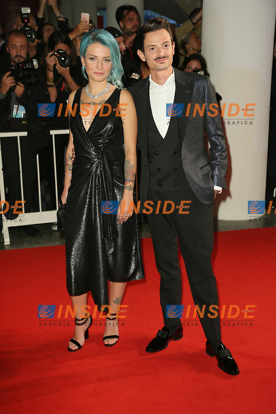 """VENICE, ITALY - SEPTEMBER 06: Karen Rebecca Casiraghi and Fabio Rovazzi walk the red carpet ahead of the """"Waiting For The Barbarians"""" screening during the 76th Venice Film Festival at Sala Grande on September 06, 2019 in Venice, Italy. (Photo by Mark Cape/Insidefoto)<br /> Venezia 06/09/2019"""