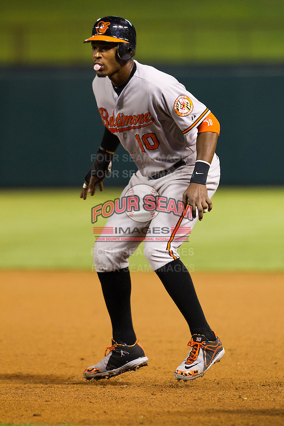 Baltimore Orioles outfielder Adam Jones #10 leads off of first base during the Major League Baseball game against the Texas Rangers on August 21st, 2012 at the Rangers Ballpark in Arlington, Texas. The Orioles defeated the Rangers 5-3. (Andrew Woolley/Four Seam Images).