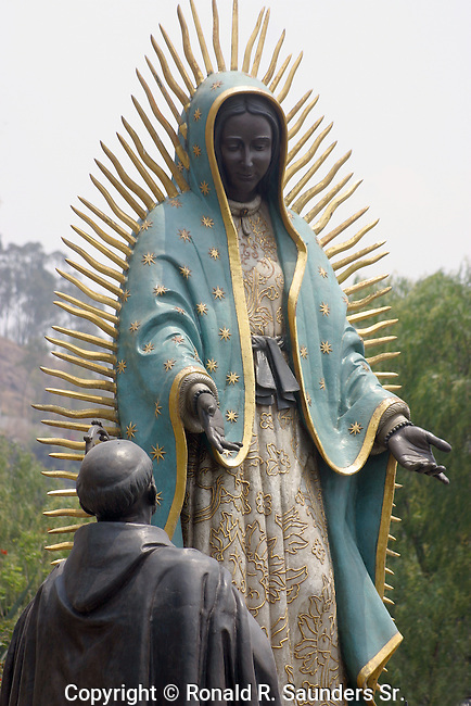 (LIFESIZE SCULPTURES) STATUE DEPICTING A DEVOTEE HUMBLY GIVING OFFERINGS to the VIRGIN MARY on TEPEYEC HILL (1)<br />