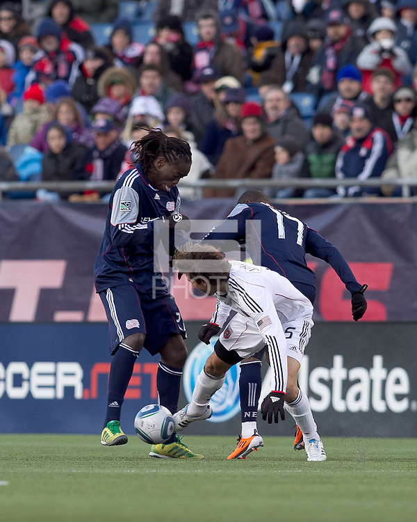 New England Revolution midfielder Shalrie Joseph (21) attempts to bring the ball out as DC United defender Dejan Jakovic (5) defends. In a Major League Soccer (MLS) match, the New England Revolution defeated DC United, 2-1, at Gillette Stadium on March 26, 2011.