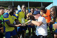 Haringey Chairman Aki Achikllea celebrates with the Bostik trophy  during Haringey Borough vs Canvey Island, Bostik League Division 1 North Play-Off Final Football at Coles Park Stadium on 6th May 2018