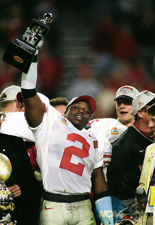 3 JAN 2003:  Strong safety Michael Doss (2) of Ohio State University shows off his defensive MVP award and celebrates the Buckeyes victory over Miami University during the National Championship Fiesta Bowl held at Sun Devil Stadium in Tempe, AZ.  Ohio State defeated Miami 31-24 in double overtime to win the national championship.  Jamie Schwaberow/NCAA Photos