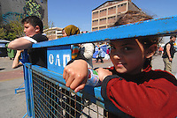 Pireus / Athens 30/3/2016<br /> Refugee camp in Pireus Port. Most of them are women with children coming from Syria.<br /> In the picture some kids waiting food distribution.<br /> Photo Livio Senigalliesi
