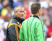 Houston coach Dominic Kinnear chats with referee's assistant Bob Fereday. The Houston Dynamo defeated the New England Revolution 2-1 in the finals of the MLS Cup at RFK Memorial Stadium in Washington, D. C., on November 18, 2007.