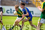 Kerry's Daire Cleary and Roscommon's Jack Keane in action during the Kerry V Roscommon U17 match at Cusack Park Ennis on Saturday. Photograph by Eamon Ward