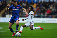 Craig Noone of Bolton Wanderers vies for possession with Nathan Dyer of Swansea City during the Sky Bet Championship match between Swansea City and Bolton Wanderers at the Liberty Stadium in Swansea, Wales, UK.  Saturday 02 March, 2019