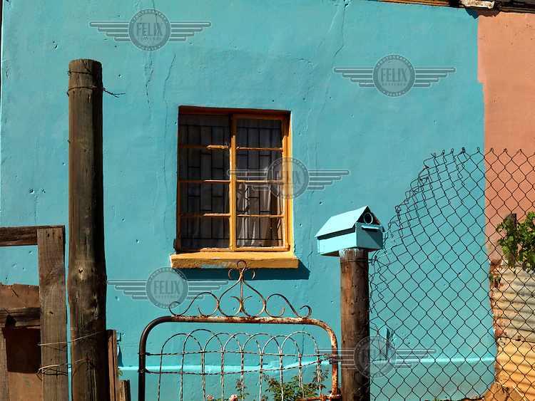 A house painted with bright blue paint.