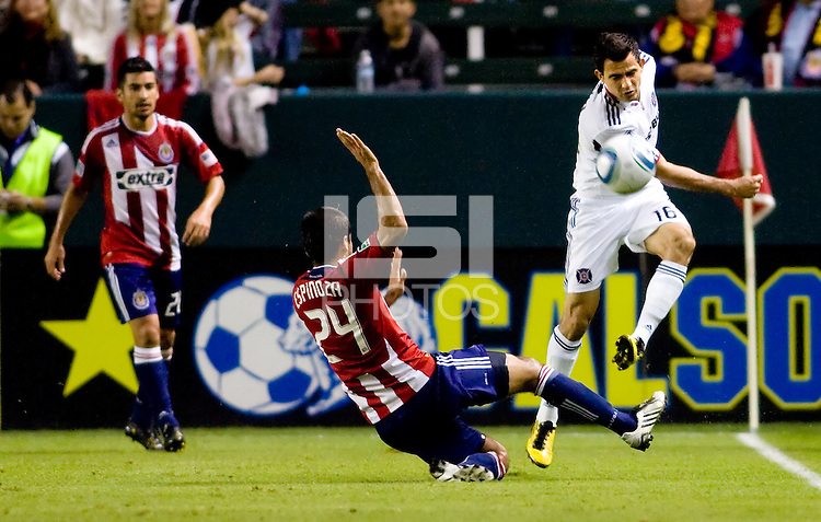 Chivas USA midfielder Rodolfo Espinoza and Chicago Fire midfielder Marco Pappa battle for a loose ball. The Chicago Fire defeated CD Chivas USA 3-1 at Home Depot Center stadium in Carson, California on Saturday October 23, 2010.