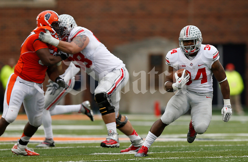 Ohio State Buckeyes running back Carlos Hyde (34) runs the football as \Ohio State Buckeyes offensive linesman Taylor Decker (68) blocks Illinois Fighting Illini defensive lineman Tim Kynard (59) during Saturday's NCAA Division I football game at Memorial Stadium in Champaign, Il., on November 16, 2013. Ohio State won the game 60-35. (Barbara J. Perenic/The Columbus Dispatch)