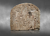 Ancient Egyptian stele depicting Sethy I adoring Amenhotep I and Nefertari, limestone, New Kingdom, 19th Dynasty, (1279-1213 BC), Deir el-Medina,  Egyptian Museum, Turin. Grey background. Schiaparelli Cat 6189.