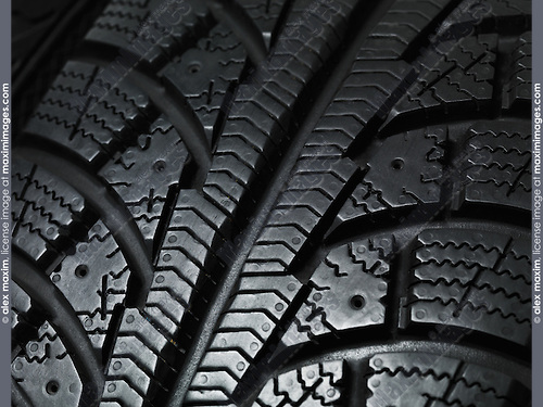 Closeup of a winter car tire tread texture