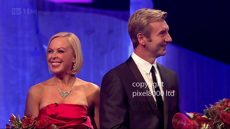 Dancing On Ice.presenters Philip Scofield and Torvill and Dean try to see the funny side....Pamela Anderson dancing on the show with partner  Matt Evers .Wardrobe malfunction - for Pamela in the dance off as her boobs fell out of her dress and she stumbled as well..Voted off first week by judges.......Pic ITV supplied by Pixel 8000 Ltd.