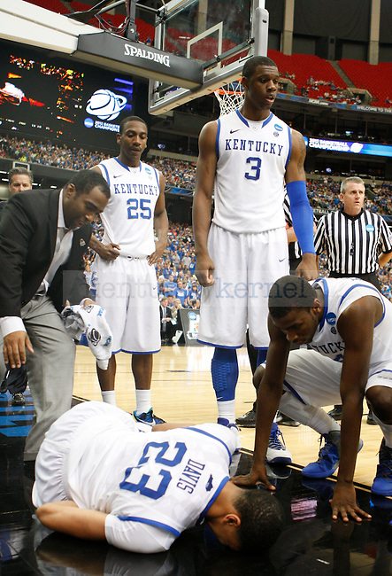 Anthony Davis after falling in the second half of the south region final between the University of Kentucky and Baylor University in the NCAA Tournament, in the Georgia Dome, on Sunday, March 25, 2012 in Atlanta, Ga. Kentucky defeated Baylor 82-70.  Photo by Latara Appleby | Staff. ..