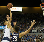 Nevada forward Trey Porter (15) takes shot over Akron's Jaden Sayles (23) in the first half of an NCAA college basketball game in Reno, Nev., Saturday, Dec. 22, 2018. (AP Photo/Tom R. Smedes)