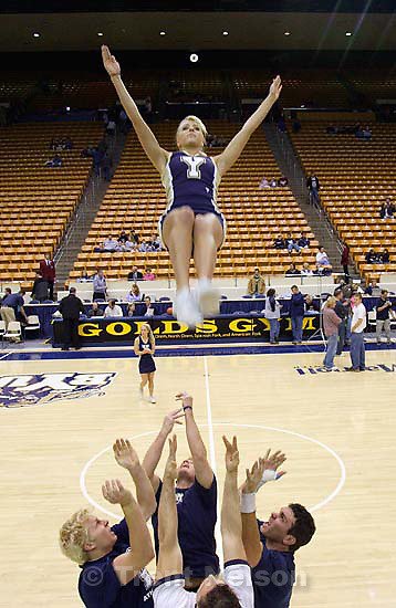 cheerleader, player introduction pre-game monopod shots. BYU vs. San Diego State University basketball Saturday night at the Marriott Center.; 1.08.2005<br />
