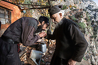 Mount Athos - The Holy Mountain.<br /> A monk kisses the hand of Father Arsenios for his 'blessing'.<br /> <br /> Photographer: Rick Findler