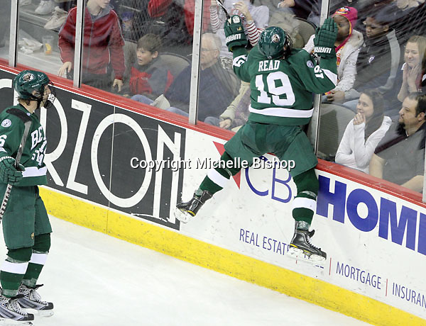 Bemidji State's Matt Read leaps into the glass after scoring in overtime. Looking on is Emil Billberg. Read's second goal of the game gave Bemidji State a 3-2 win over UNO Saturday night at Qwest Center Omaha. (Photo by Michelle Bishop)