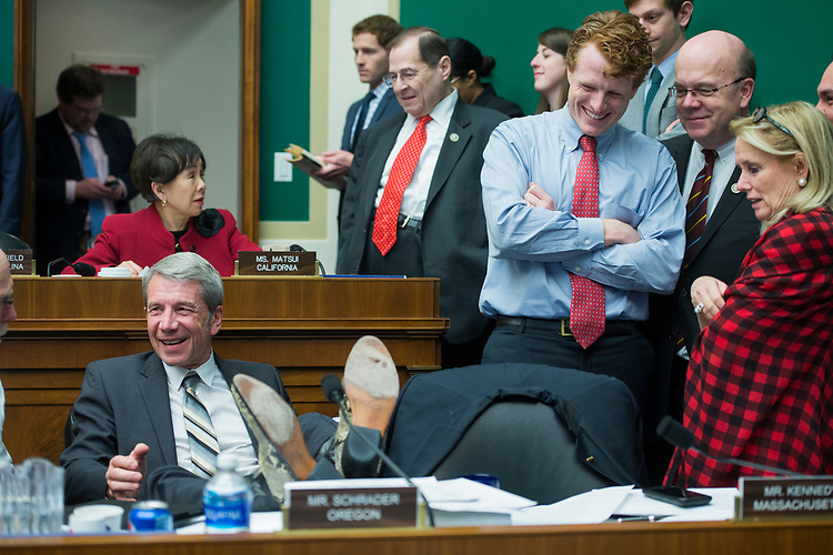 UNITED STATES - MARCH 9: Rep. Kurt Schrader, D-Ore., kicks back as Reps. Joe Kennedy III, D-Mass., Jim McGovern, D-Mass., and Debbie Dingell, D-Mich., look on, after the 24-hour mark of a House Energy and Commerce Committee markup in Rayburn Building regarding the bill to repeal and replace the the Affordable Care Act, March 9, 2017. The markup has been underway since 10:30 a.m., Wednesday. (Photo By Tom Williams/CQ Roll Call)