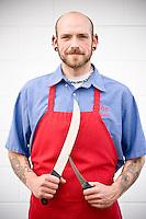 Russ Brown, the meat cutter, outside Elias' Butcher Shop in Roanoke Rapids, North Carolina.