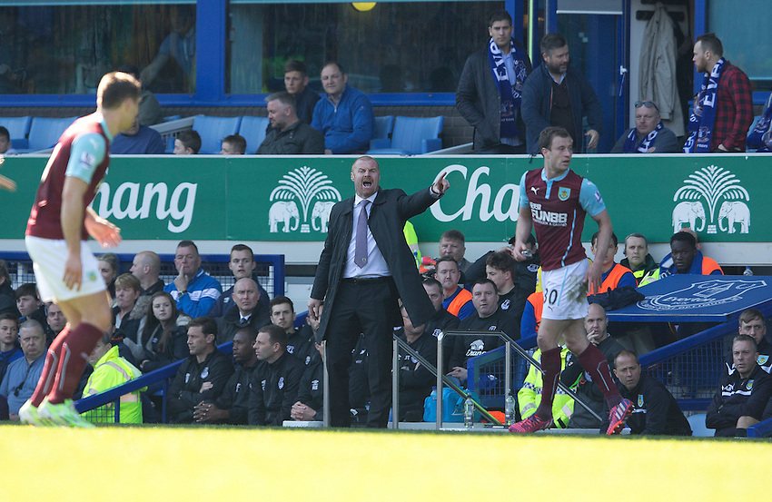 Burnley manager Sean Dyche shouts instructions to his team from the dug-out<br /> <br /> Photographer Stephen White/CameraSport<br /> <br /> Football - Barclays Premiership - Everton v Burnley - Saturday 18th April 2015 - Goodison Park - Everton<br /> <br /> &copy; CameraSport - 43 Linden Ave. Countesthorpe. Leicester. England. LE8 5PG - Tel: +44 (0) 116 277 4147 - admin@camerasport.com - www.camerasport.com