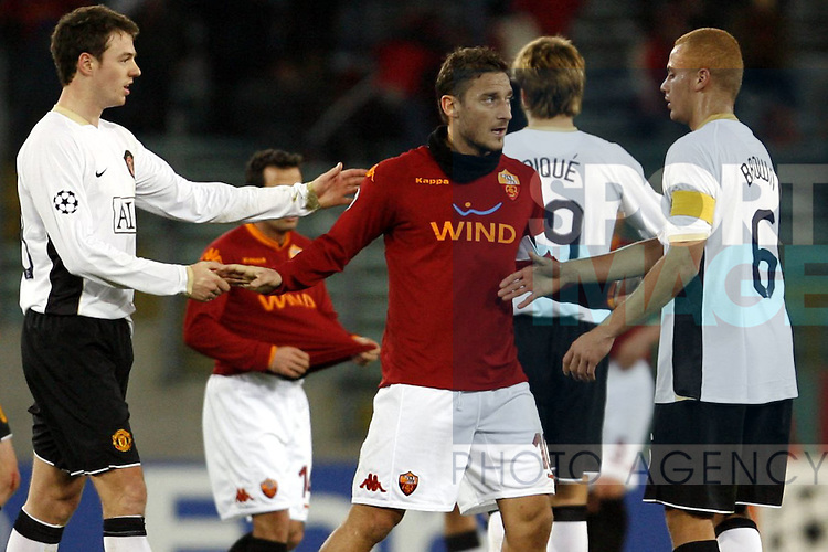 Francesco Totti of Roma and Jonny Evans shake hands at the end of the match