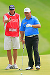 Damien McGrane and his caddy line up his putt on the 18th hole to finish his round with a magnificent 66 on the 3rd Day of The Celtic Manor Wales Open, 5th June 2010 (Photo by Eoin Clarke/GOLFFILE).